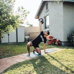 Man Lifting Kettlebell Outdoors