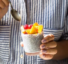 Woman Holding Fruit Cup with Chia Seeds