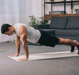 Man Doing Push-ups on Living Room Floor