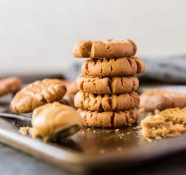 Stack of Cookies on Tray with Spoonful of Peanut Butter