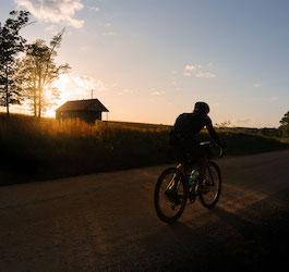 Man Riding on Cycling Trail through Farmland
