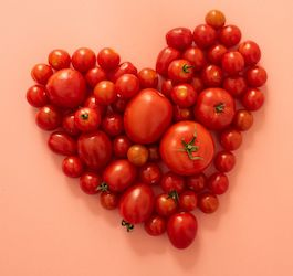 Group of Tomatoes Laid Out in Heart Shape
