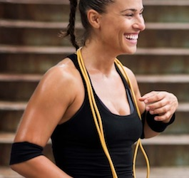 Smiling Woman with Jump Rope Draped around Neck