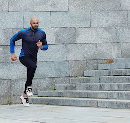 Man Running Next to Stone Steps