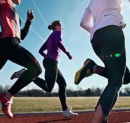 Group of Women Running on Track