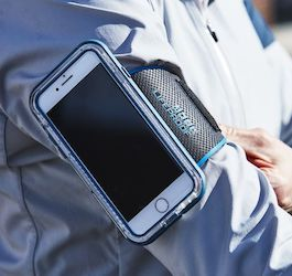 Man's Arm with Armband for Phone Strapped to It