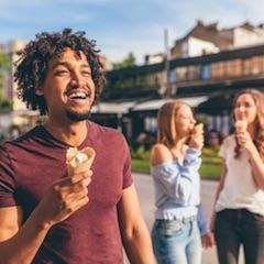 Man Enjoying Ice Cream with Friends