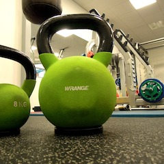 Green Kettle Bells on a Floor in a Gym