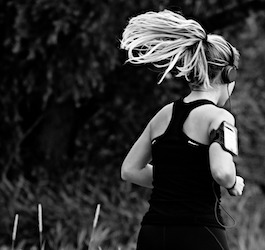 Woman Running with Long Ponytail and Headphones (MabelAmber via Pixabay)