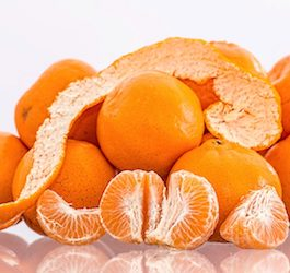 Pile of Tangerines Whole Peeled and Separated