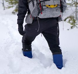 Man Backpacking in Shin-High Powder Snow