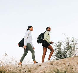 Two Hiking Outdoors with Backpacks