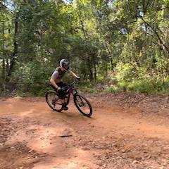 Woman Riding Mountain Bike on Trail