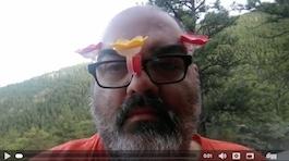 Man Wearing Hummingbird Feeders