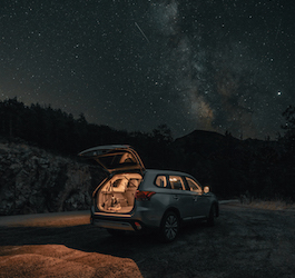 Long Exposure of SUV in Wilderness with Milky Way Overhead