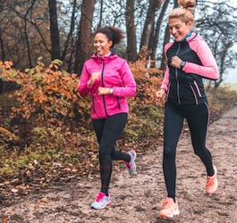 Two Women Jogging on Running Trail during Autumn