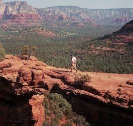 Man Walking across Devil's Bridge (Blake Carpenter via unsplash)