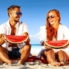 Couple on Beach Eating Watermelon