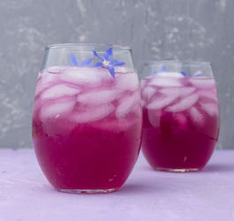 Glasses with Purple Beverage on Ice