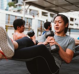 Cross-Legged Woman Working Out with Weight