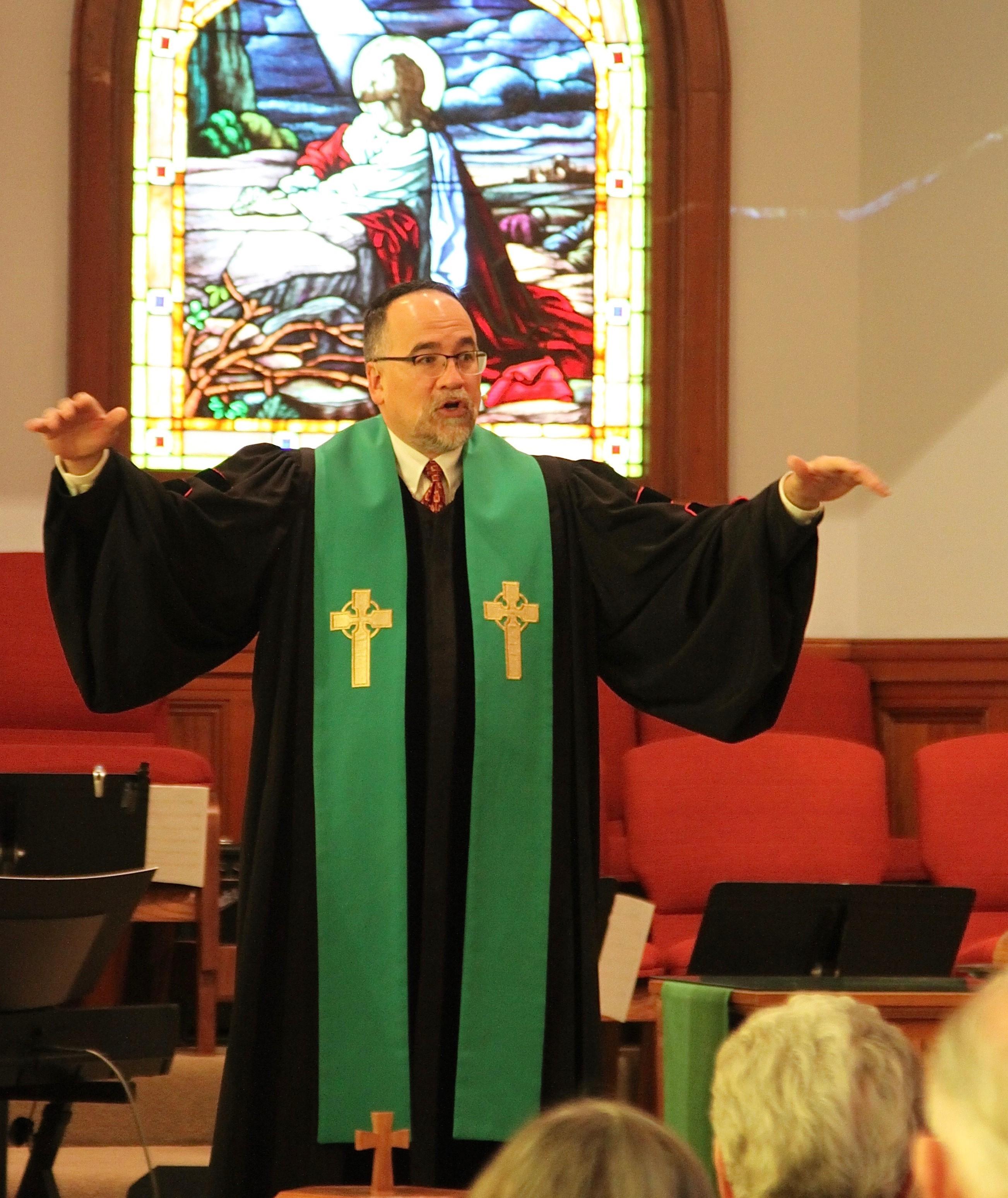 Pastor Matt speaking to the congregation.