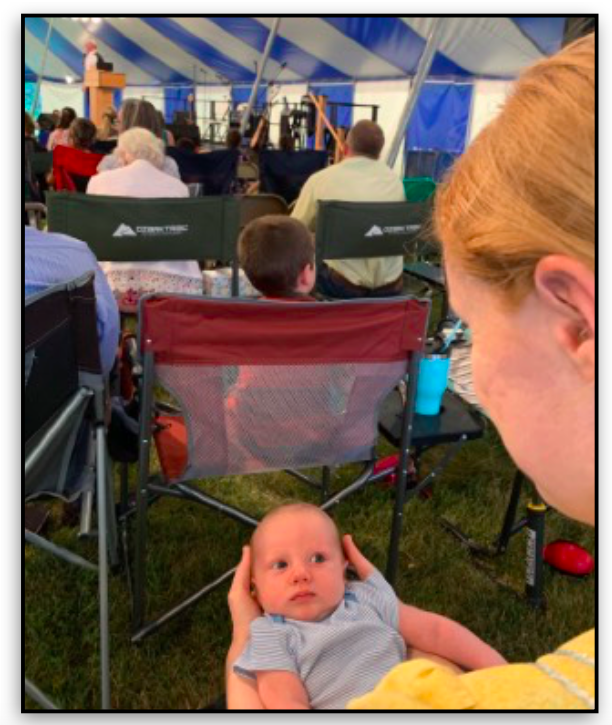 Baby at tent meeting