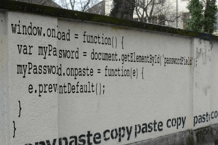 Wall with copy paste graffiti on it.