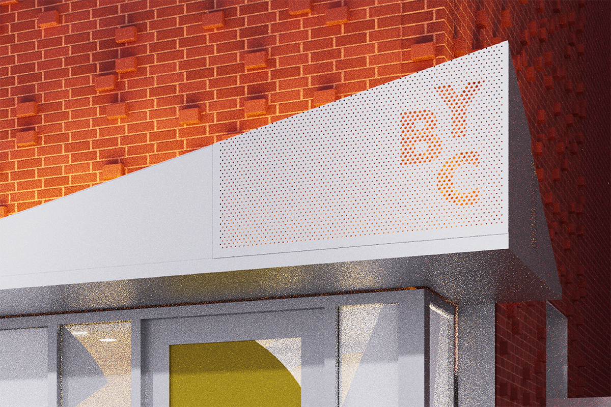 Closeup of a minimalist modern sign with the letters BYC, in front of a orange brick building