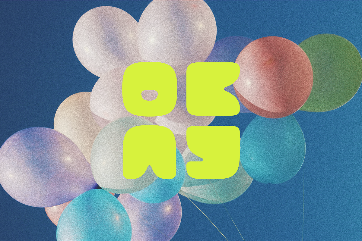 A lime green logo that says OKAY sits on top of colorful photo of balloons