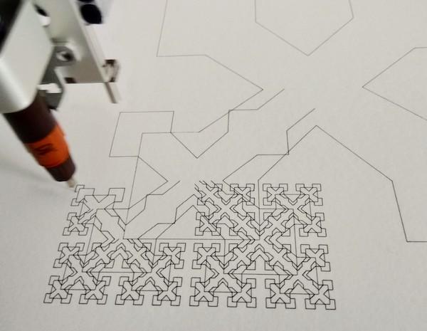 Axidraw plotting a fractal. Photo by Sher Minn Chong