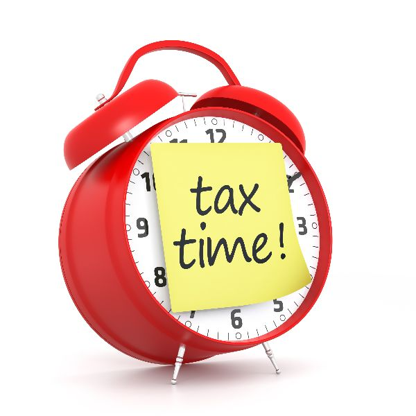 """alarm clock with post-it note """"tax time!"""""""