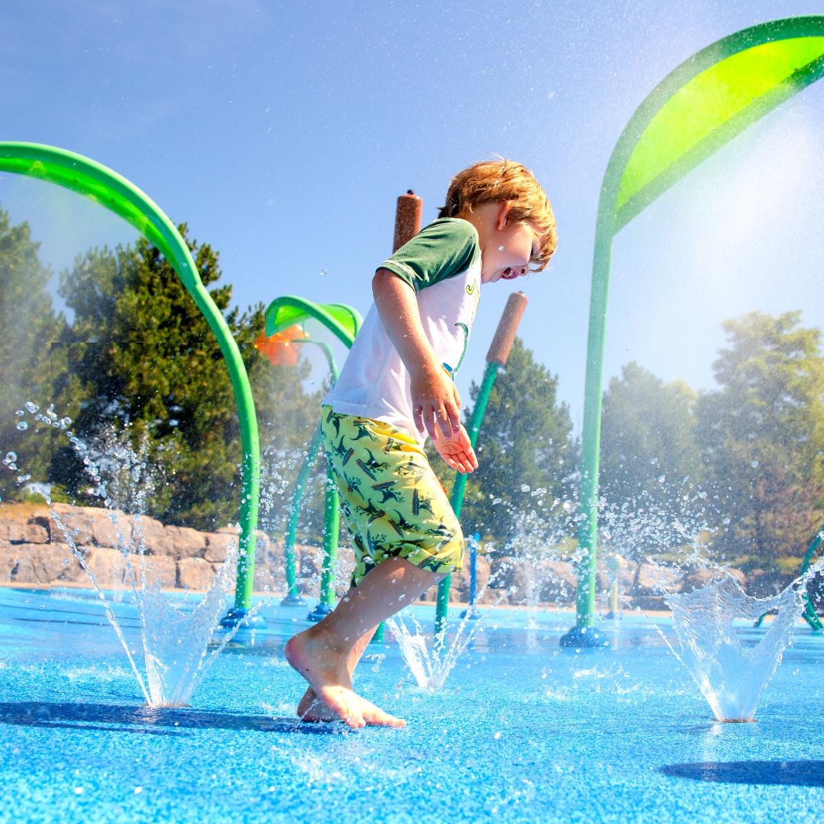 A young boy plays at the MacBain Centre splash pad.