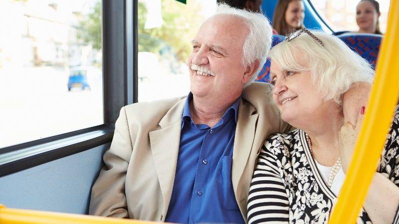 Two seniors riding transit