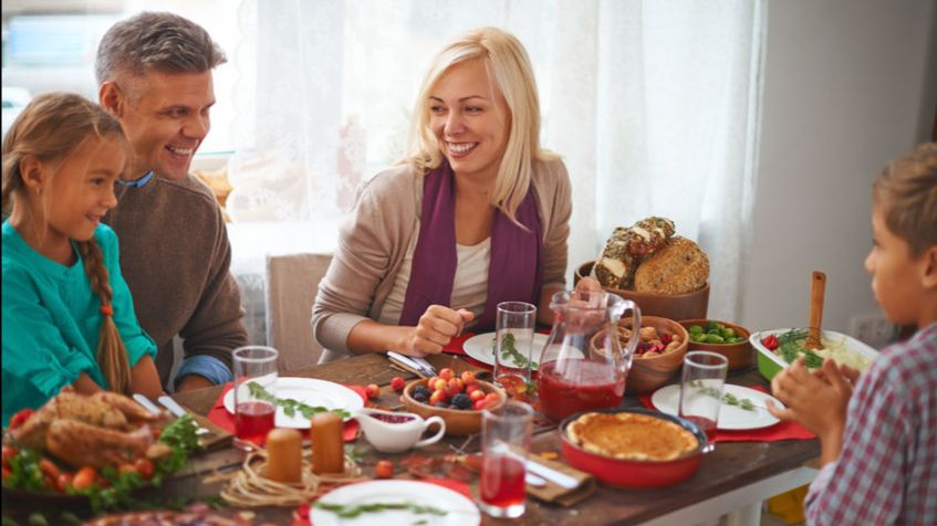 Family celebrates a Thanksgiving meal