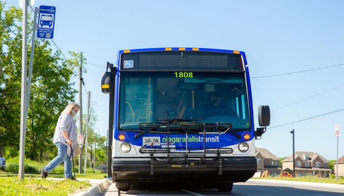 Woman boarding a Niagara Falls Transit bus