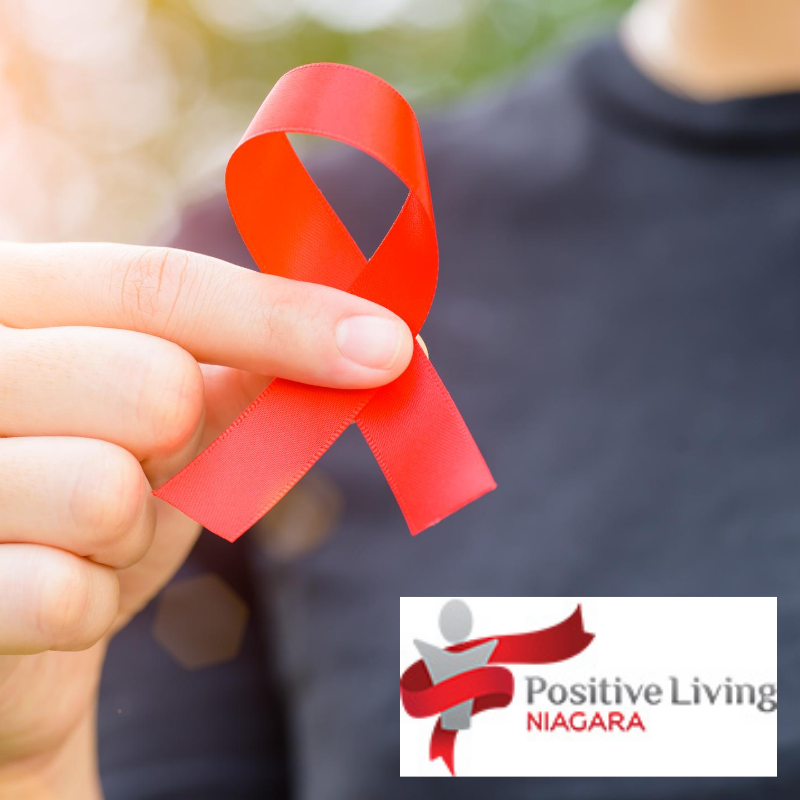 A red ribbon and the Positive Living Niagara logo (a red scarf wraps around a grey figure).