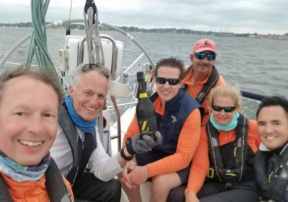 Junior crew sailing offshore