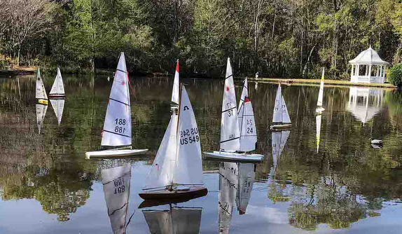 Model yachting/ sailing on a pond