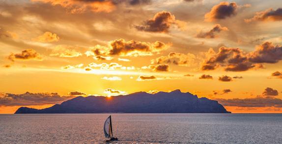 J/122 sailing off Lampedusa sunset