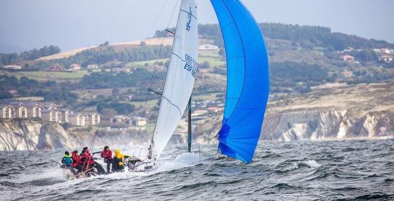 J/80 sailing fast off Getxo, Bilbao, Spain