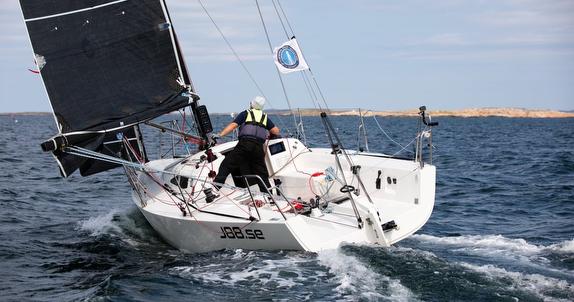 J/88 sailing singlehanded off Marstrand, Sweden