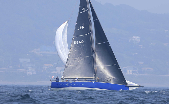 J/121 setting spinnaker sailing off Japan