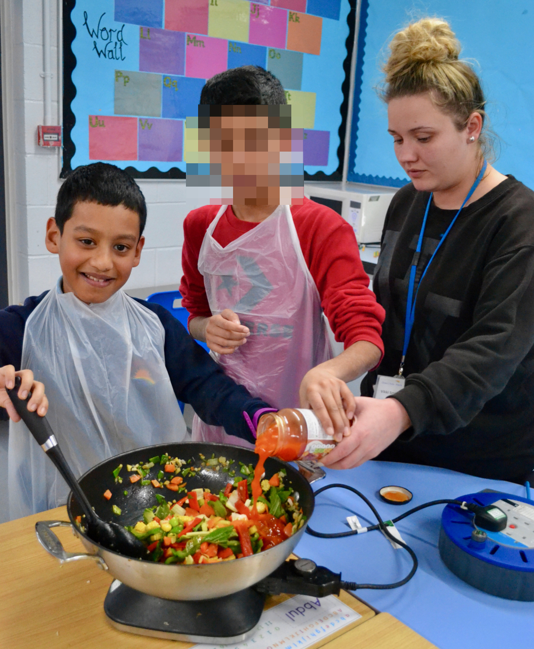 Boys with teacher cooking