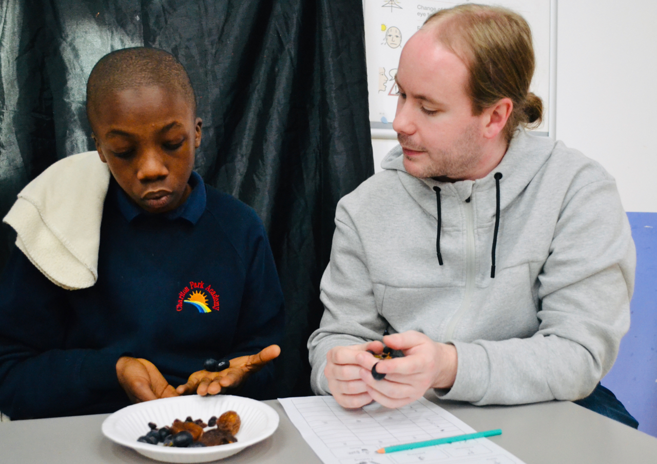 teacher and student eating dried fruit