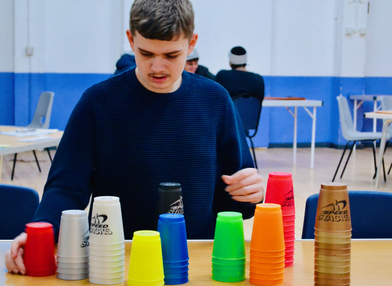 Boy with coloured cups