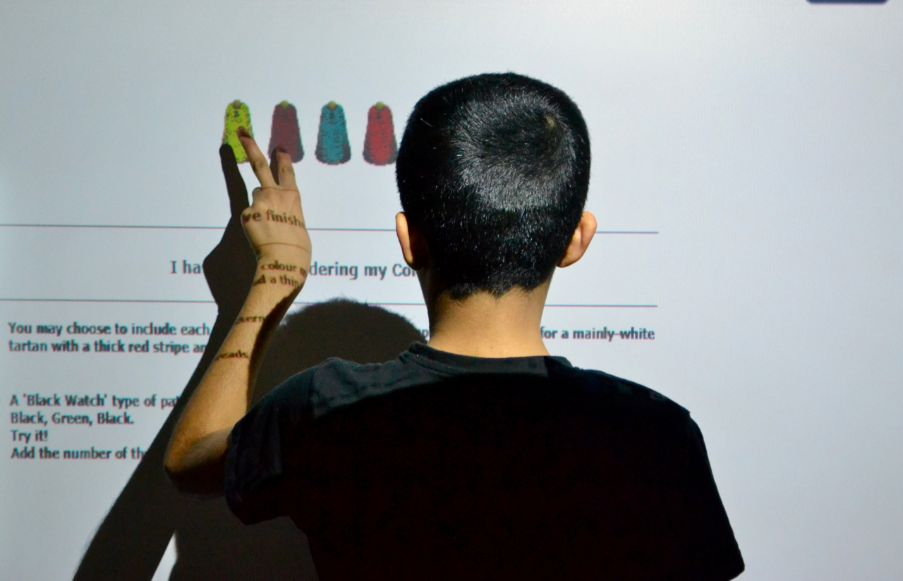 Student using smart board