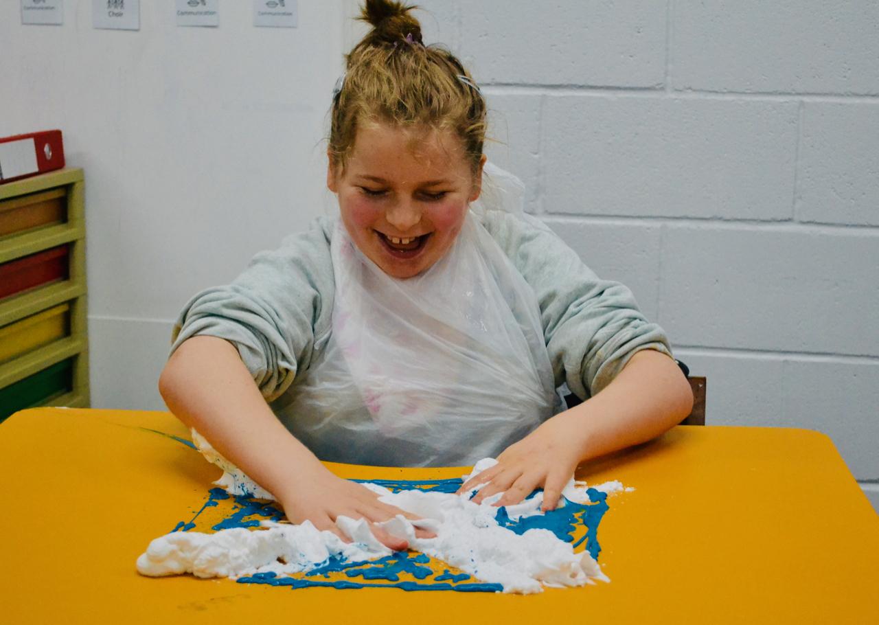 young girl enjoying sensory play