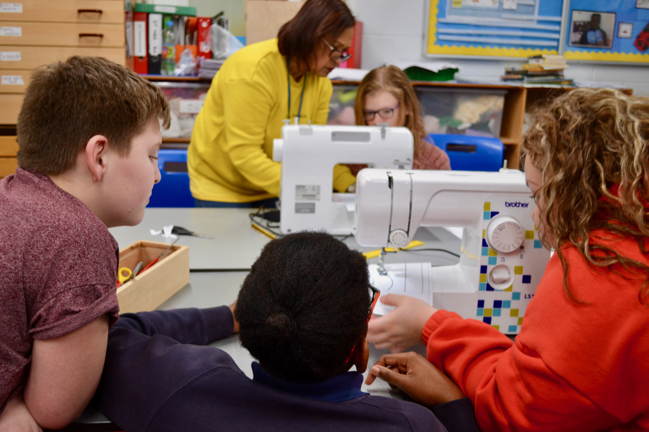 children using a sewing machine