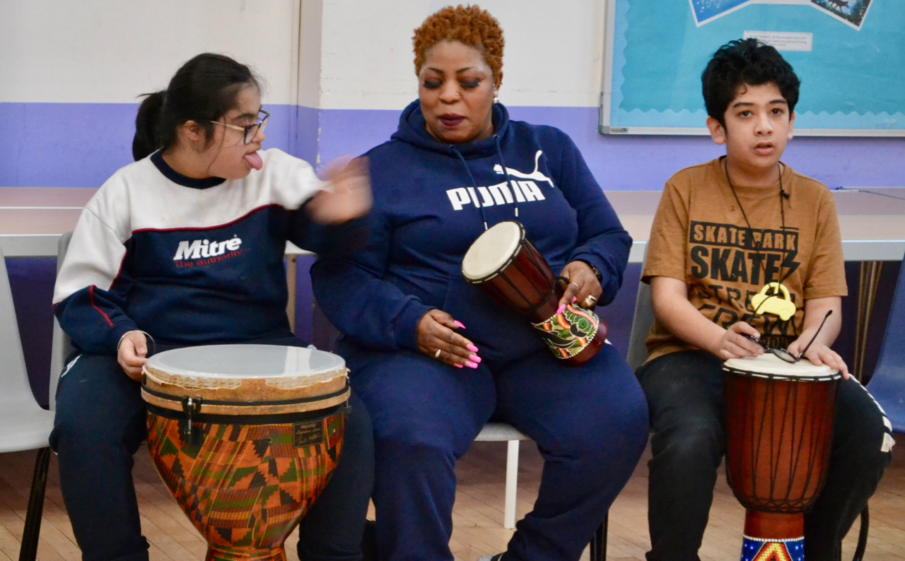 students and teacher drumming