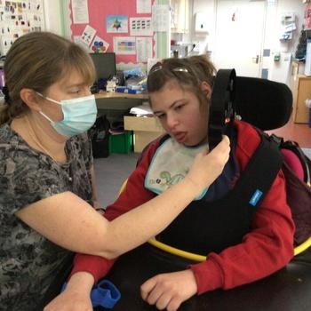 Girl in a wheelchair with a teacher